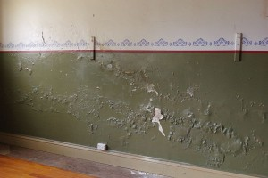The interior plaster work on the north wall clearly showing damp damage.