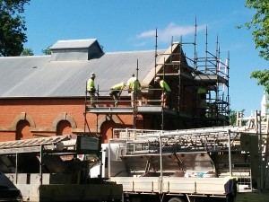 The west end of Museum hall with scaffolding and workers galore.