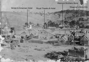 Left frame of panorama showing the British & American Hotel, rear of Royal Hotel and Theatre, Warnock Bros' Store and Wagener's brick kiln.